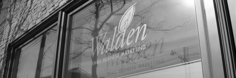 Walden logo on window of office